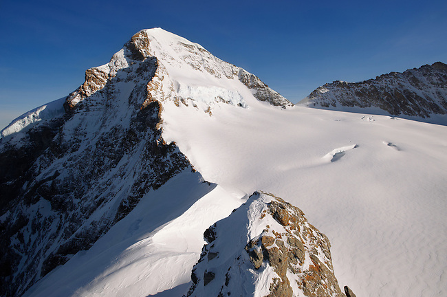 Eiger Summit in snow. Top Of Europe. Bernese Oberland, swiss Alps, Switzerland.