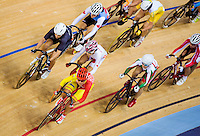 06 AUG 2012 - LONDON, GBR - Leire Olaberria Dorronsoro (ESP) (in red and yellow) of Spain leads a pack during the Women's Omnium 20km Points Race at the London 2012 Olympic Games track cycling at the Olympic Park Velodrome in Stratford, London, Great Britain .(PHOTO (C) 2012 NIGEL FARROW)