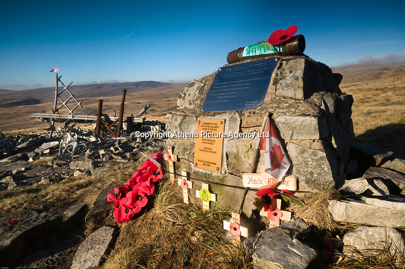 """Pictured: Tributes and a Canadian flag left at the site of the MF509 Wellington Bomber crash in the Brecon Beacons, Wales, UK.<br /> Re: The nephew of a World War II airman whose plane crashed into a Welsh mountain has climbed the peak to pay tribute to the uncle he never met.<br /> Dr Peter Paré, 74, travelled from his home in Vancouver, Canada, to read a poem at the desolate spot where his uncle Bill Allison was killed.<br /> Flying officer Allison, 28, was one of the six crew of a Wellington Bomber that crashed on a training flight in November 1944.<br /> The plane wreckage is still scattered over Carreg Goch in the Brecon Beacons where hundreds of young airmen learned to prepare for bombing missions.<br /> Dr Paré said: """"I wanted to make this pilgrimage even though I was a baby when he died and never met Bill Allison.<br /> """"We only found out about the crash site recently and it is remarkable that so much of the plane is still here.""""<br /> Flying officer Allison was the oldest on board when the plane's starboard engine developed a fault during a low-flying exercise.<br /> For years local people have honoured the brave airmen by flying a Canadian flag at the scene - replacing it every time it gets ripped by strong winds.<br /> Dr Paré, retired Professor of Medicine at the University of British Columbia, said: """"It was very moving to see the Maple Leaf flying where my uncle died all those years ago.<br /> """"It brought a tear to my eye as I read the poem I wrote in his honour."""""""