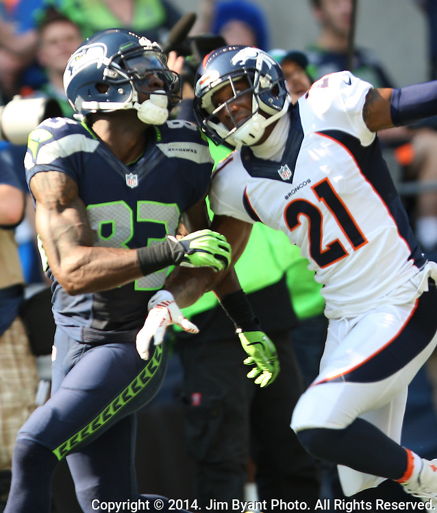 Seattle Seahawks wide receiver Ricardo Lockette (83) gets in position against  Denver Broncos cornerback Aqib Talib (21) to catch a 39-yard touchdown pass from quarterback Russell Wilson in the first quarter at CenturyLink Field in Seattle, Washington on September 21, 2014. The Seahawks won 26-20 in overtime.    ©2014. Jim Bryant Photo. All rights Reserved.