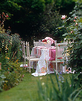 A beautifully decorated table hidden in the garden makes a magical setting for an al fresco lunch