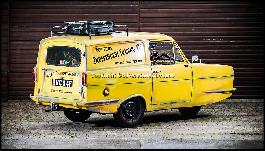 BNPS.co.uk (01202 558833)Pic: SilverstoneAuctions/BNPS<br /> <br /> Nice little earner...<br /> <br /> A yellow three wheeled van driven by Del Boy in Only Fools and Horses has sold for almost £42,000.<br /> <br /> The iconic motor was used in the 2001 episode 'If They Could See Us Now' of the classic sitcom when Del and Rodney had become millionaires.<br /> <br /> The 1968 Reliant Regal van was bought by the BBC who painted it yellow and installed the Trotters Independent Traders sign on it.<br /> <br /> After filming was finished the motor was bought by an Only Fools and Horses superfan who sold it at the weekend.