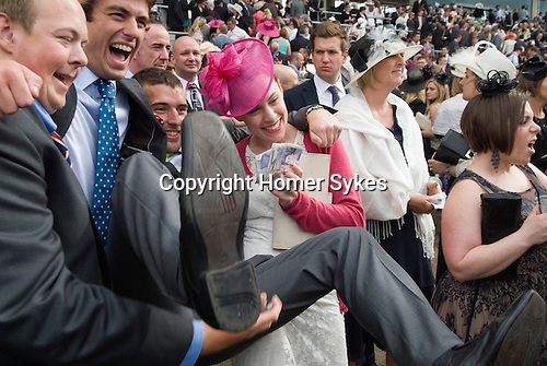 Royal Ascot horse racing Berkshire. 2012 Winners and looser. Couple with friends celebrate a win, while woman to right looks like her horse is not going to win.