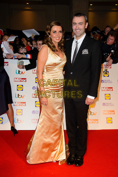 Carol Vorderman, Graham Duff<br /> The Daily Mirror's Pride of Britain Awards arrivals at the Grosvenor House Hotel, London, England.<br /> 7th October 2013<br /> full length dress gold silk satin black suit couple<br /> CAP/CJ<br /> &copy;Chris Joseph/Capital Pictures