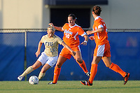 21 August 2011:  FIU's Nicole DiPerna (16) moves the ball while being defended by Florida's Holly King (10) in the first half as the University of Florida Gators defeated the FIU Golden Panthers, 2-0, at University Park Stadium in Miami, Florida.