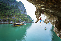 Neil Gresham, the Deep Water Soloing (DWS) pioneer, and one of the world's best all round climbers high above Ha Long Bay, Vietnam<br />