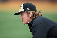 Garrett Kelly (28) of the Wake Forest Demon Deacons watches the action from the dugout during the game against the Towson Tigers at Wake Forest Baseball Park on March 1, 2015 in Winston-Salem, North Carolina.  The Demon Deacons defeated the Tigers 15-8.  (Brian Westerholt/Four Seam Images)