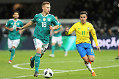 27th March 2018, Olympiastadion, Berlin, Germany; International Football Friendly, Germany versus Brazil; Joshua Kimminch (Germany) breaks from Philippe Coutinho (Brazil)