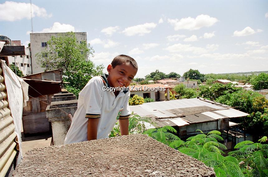Young boy, shanty town alongside Congressional Building, Asuncion, Paraguay.