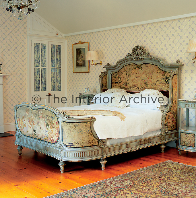 A traditional bedroom with an early 19th century French sleigh bed, which comes with matching oval bedside tables.