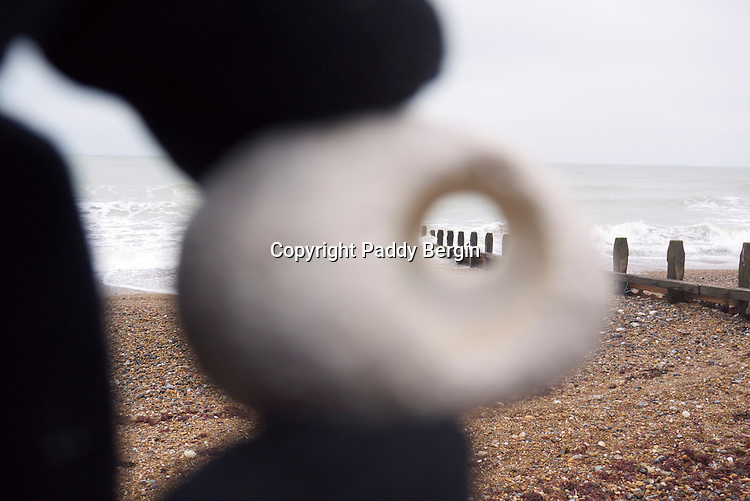 Beach stone or pebble with a hole through its centre.<br />