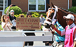 A fan holds up a sign urging Maximum Security to leave for the Preakness as he schools in the paddock at Monmouth Park in Oceanport, New Jersey on Saturday May 18, 2019. Photo By Bill Denver/EQUI-PHOTO