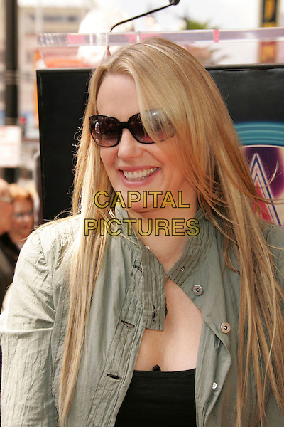 DARYL HANNAH .Recieves Star on The Hollywood Walk Of Fame, Hollywood, California, USA..April 6th, 2006.Photo: Russ Elliot/AdMedia/Capital Pictures.Ref: RE/ADM.headshot portrait sunglasses shades .www.capitalpictures.com.sales@capitalpictures.com.© Capital Pictures.
