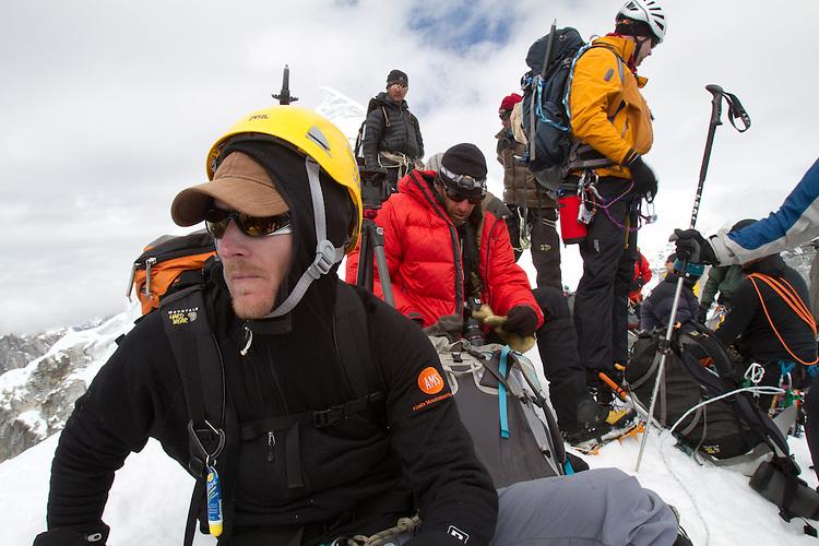 Matt Nyman on the summit of Lobuche. Photo by Didrik Johnck.