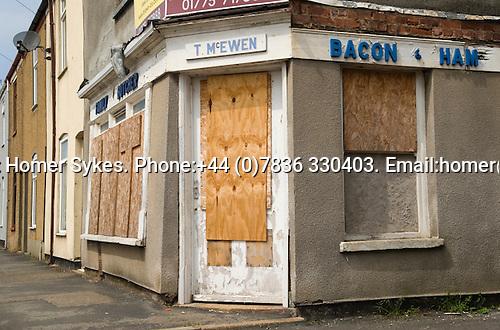 Family Butchers corner shop boareded up closed down Sutton Bridge, Lincolnshire. UK 2008.