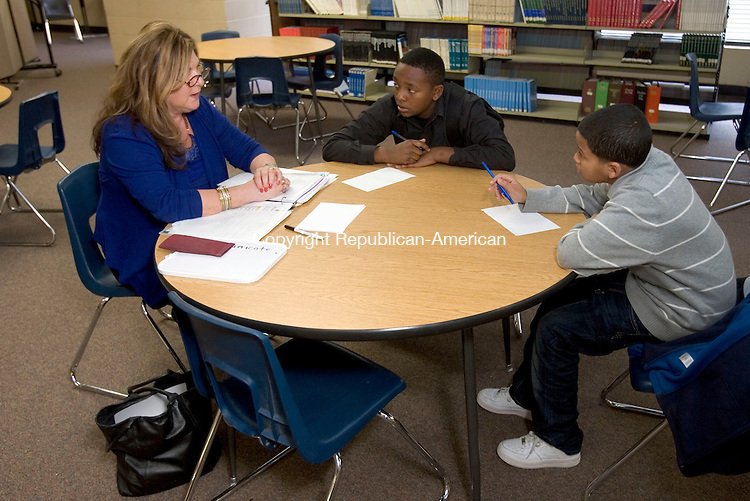 WATERBURY, CT. 28 November 2012-112812SV04-From left, Sylvia Demicco mentors Damien Wade, 13, and Eddy Valdez, 12, of Waterbury at North End Middle School in Waterbury Wednesday. The new 7-year, $11.2 million, program of mentoring and tutoring is intended to get city children ready for college..Steven Valenti Republican-American