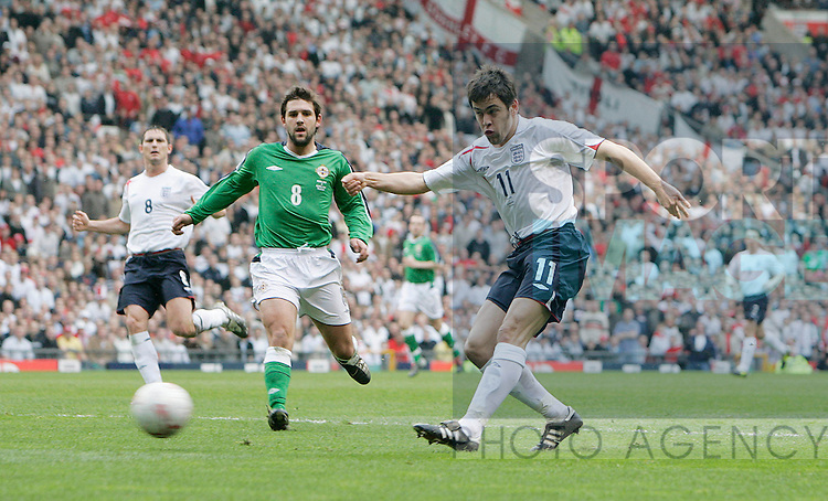 England's Joe Cole shoots against Northern Ireland in the World Cup qualifying match at Old Trafford, Manchester, March 27, 2005..Pic © Simon Bellis, 33 Parkway New Mills, High Peak, SK22 4DU..Any problems call 07980659747 or 01663 746519. .email: simon@simonbellis.com