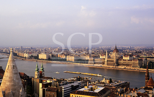 Budapest, Hungary. View from Buda over the Danube river with traffic; Pest and parliament building; fishermen's bastion.