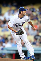 Los Angeles Dodgers pitcher Clayton Kershaw #22 pitches against the Cincinnati Reds at Dodger Stadium on June 14, 2011 in Los Angeles,California. (Larry Goren/Four Seam Images)