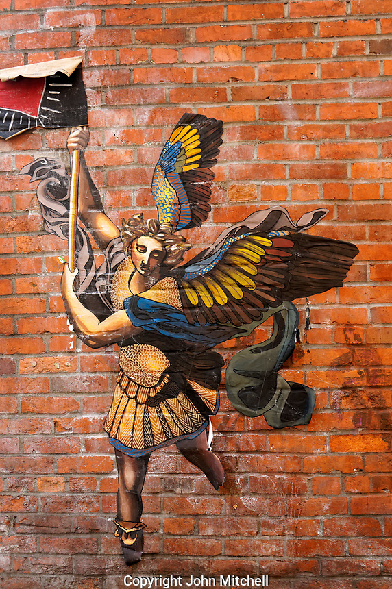 Paper angel mural street art on a brick wall in the Pioneer Square neighborhood of Seattle, Washington, USA