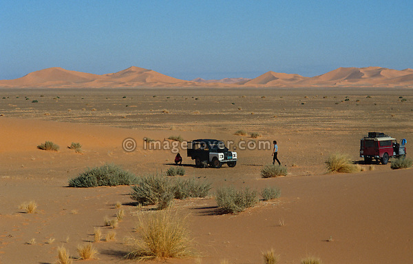 Africa, Algeria, Sahara Desert. Travellers, undertaking a sahara trip with their Series Land Rovers, having a rest in the scenic setting of the Sahara Desert. --- No releases available. Automotive trademarks are the property of the trademark holder, authorization may be needed for some uses.