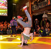 Germany, DEU, Herne, 2015Nov07: A young break dancer performs on a stage.