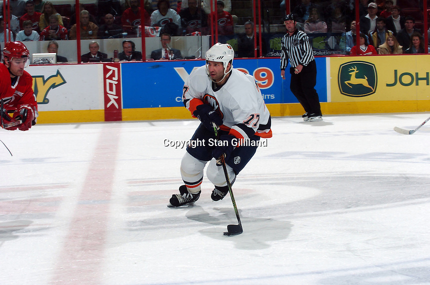 New York Islanders' Alexei Zhitnik (77) of the Ukraine brings the puck up ice during their game with the Carolina Hurricanes Thursday, Jan. 19, 2006 in Raleigh, NC. Carolina won 4-3.