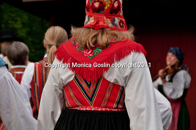 Costumes of folk dancers in Stockholm, Sweden performing at Skansen, a park full of traditional builings and farmsteads from all over Sweden