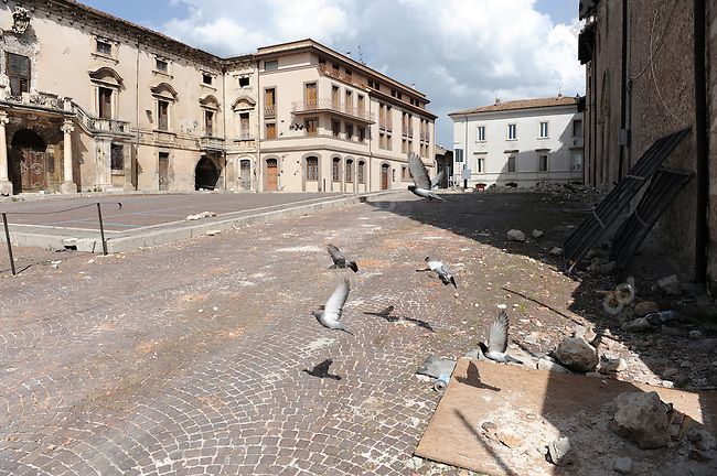 In the historic centre of L'Aquila, from which 50,000 people were evacuated in the wake of the devastating earthquake of early April, pigeons flew in an empty square. May 24, 2009
