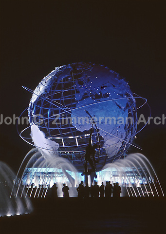 1964 World's Fair, Flushing Meadows, New York. Visitors silhouetted beneath the Unisphere. Photo by John G. Zimmerman.