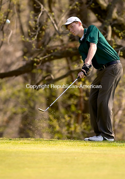 WATERBURY, CT- 24 APRIL 2008 --042408JS10--Holy Cross' Iam Walsh chips onto the green during their meet against Wolcott Thursday at Western Hills Golf Course in Waterbury. <br /> Jim Shannon / Republican-American