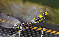 Jul. 1, 2011; Daytona Beach, FL, USA; NASCAR Nationwide Series drivers Tony Stewart (9), Steve Wallace (66) and Brian Scott (11) crash as they take the checkered flag during the Subway Jalapeno 250 at Daytona International Speedway. Mandatory Credit: Mark J. Rebilas-