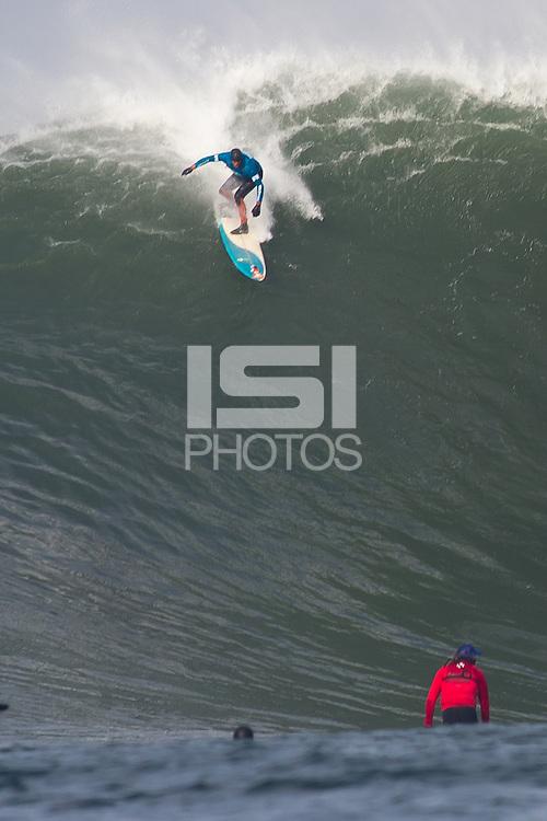 Half Moon Bay, California - January 24, 2014: 2014 Maverick's Invitational Peter Mel navigating the drop.