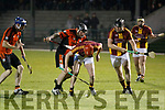Ballyheigue B and Duagh players scramble for the ball during the Garveys Supervalue Junior Hurling Championship Final played last Friday evening under lights at Abbeydorney GAA ground