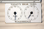 Two clocks showing times of high tides at Woodbridge, Suffolk, England