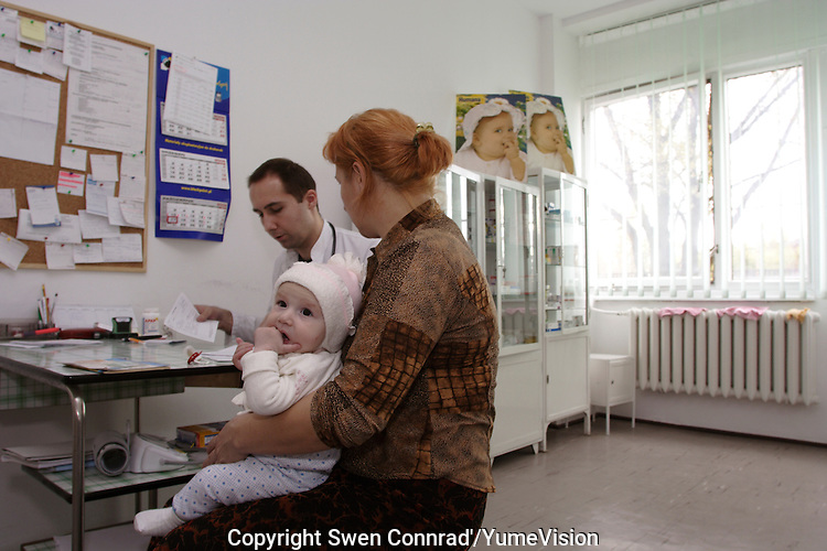 Chechen mother with her five months baby at the medical clinic in the URiC Bielany refugee centre, in Poland..-For security reason, the face of the adult asylum seeker have been evicted of the photography..-For security reason, the names of the adult asylum seeker have been change. .-Article 9 of the Act of 13 June 2003 on grating protection on the Polish territory (Journal of Laws, No 128, it. 1176) personal data of refugees are an object of particular protection..-Cases where publication of a picture or name of asylum seeker had dramatic consequences for this persons and is family back in Chechnya. .Please have safety of those people in mind. Thank you.