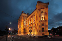 The National and University Library of Bosnia and Herzegovina at night, the national library, designed in 1891 by the Czech architect Karel Parik as the City Hall, and reopened as a library in 2014, Sarajevo, Bosnia and Herzegovina. This building, on the banks of the Miljacka river, is from the Austro-Hungarian period of the city. The building and many of its documents were damaged in 1992 during the Siege of Sarajevo in the Yugoslav War. Picture by Manuel Cohen