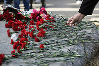 Pictured: Carnations is left at the uprising monument at the Athens Polytechinc in Athens Greece. Wednesday 16 November 2016<br /> Re: 43rd anniversary of the Athens Polytechnic uprising of 1973 which was a massive demonstration of popular rejection of the Greek military junta of 1967–1974. The uprising began on November 14, 1973, escalated to an open anti-junta revolt and ended in bloodshed in the early morning of November 17 after a series of events starting with a tank crashing through the gates of the Polytechnic.