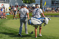 Jon Rahm (ESP) and his caddie head to retrieve the ball he just chipped in from off the green on 16 as his wooden spoon is attached to his bag during 3rd round of the World Golf Championships - Bridgestone Invitational, at the Firestone Country Club, Akron, Ohio. 8/4/2018.<br /> Picture: Golffile | Ken Murray<br /> <br /> <br /> All photo usage must carry mandatory copyright credit (© Golffile | Ken Murray)