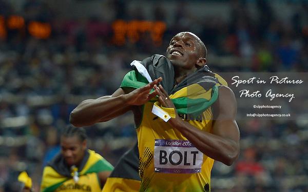Jamaica's Usain Bolt celebrates. Athletics - PHOTO: Mandatory by-line: Garry Bowden/SIP/Pinnacle - Photo Agency UK Tel: +44(0)1363 881025 - Mobile:0797 1270 681 - VAT Reg No: 768 6958 48 - 08/08/2012 - 2012 Olympics - Olympic Stadium, Olympic Park, London, England
