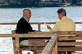 United States President Bill Clinton, right, and Prime Minister Benjamin Netanyahu of Israel sit on a deck along the banks of the Wye River at the Wye River Plantation where peace talks continue between Netanyahu and Palestinian leader Yasser Arafat for the third straight day at the secluded Maryland site, Sunday, October 18, 1998.                                                                             .Mandatory Credit: White House via CNP