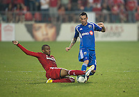 03 July 2013: Montreal Impact forward Andres Romero #15 and Toronto FC midfielder Reggie Lambe #19 in action during an MLS game between the Montreal Impact and Toronto FC at BMO Field in Toronto, Ontario Canada.<br /> The game ended in a 3-3 draw.