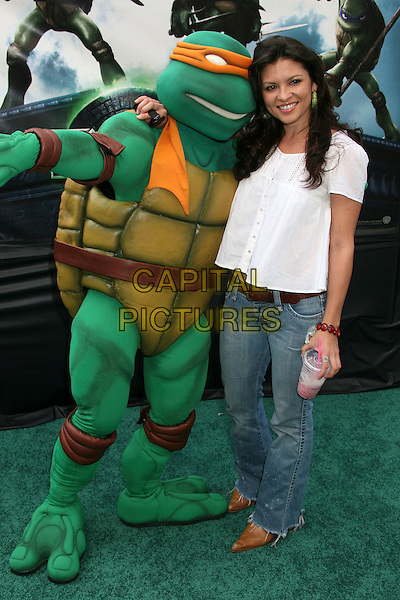 "TURTLE & ERICA MUNOZ.""TMNT"" (aka. ""Teenage Mutant Ninja Turtles"") Los Angeles Premiere at Grauman's Chinese Theatre, Hollywood, California, USA, 17 March 2007..full length turtle costume dressed-up.CAP/ADM/BP.©Byron Purvis/AdMedia/Capital Pictures."