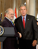 Washington, D.C. - June 24, 2005 -- United States President George W. Bush and Prime Minister Ibrahim al-Jaafari of Iraq shake hands after holding a joint press conference in the East Room at the White House in Washington, D.C. on June 24, 2005.  They discussed the re-building of Iraq and refused to give a time-table for the withdrawal of United States forces.<br /> Credit: Ron Sachs / CNP