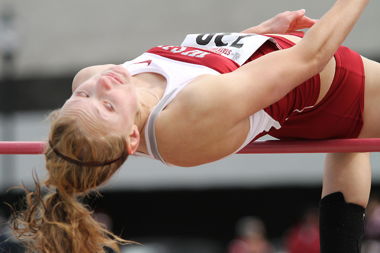 Washington State high jumper, Holly Parent, barely clears the high jump bar during the Cougars dual track and field meet with arch-rival Washington at Mooberry Track at Washington State University in Pullman, Washington, on May 1, 2010.
