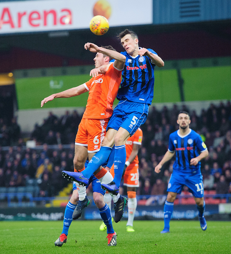 Blackpool's Ben Heneghan vies for possession with Rochdale's Ryan Delaney<br /> <br /> Photographer Chris Vaughan/CameraSport<br /> <br /> The EFL Sky Bet League One - Rochdale v Blackpool - Wednesday 26th December 2018 - Spotland Stadium - Rochdale<br /> <br /> World Copyright © 2018 CameraSport. All rights reserved. 43 Linden Ave. Countesthorpe. Leicester. England. LE8 5PG - Tel: +44 (0) 116 277 4147 - admin@camerasport.com - www.camerasport.com