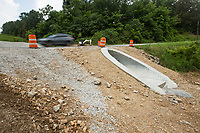 NWA Democrat-Gazette/BEN GOFF @NWABENGOFF<br /> A vehicle passes over a new trail tunnel Wednesday, July 10, 2019, on Chelsea Road in Bella Vista. The tunnel is one of the eleven namesake tunnels planned for the 11 Under trail system under construction on the West side of Bella Vista.
