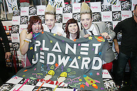 16/7/2010. Jedward are pictured with fans Chloe Evans and Hollie Watson at the launch of their new album at HMV Dundrum. Picture James Horan/Collins Photos