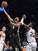 Spencer Dinwiddle #8 of the Brooklyn Nets drives past Deandre Ayton #22 of the Phoenix Suns during an NBA game at the Barclays Center in Brooklyn, NY on Sunday, Dec. 23, 2018. Dinwiddle scored a team-high 24 points to lead the Nets to a 111-103 win.