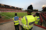 Barnsley 0 Huddersfield Town 1, 12/05/2006. Oakwell, League One Play Off Semi Final 1st Leg. Barnsley (red shirts) versus Huddersfield Town, Coca-Cola League One play-off semi-final first leg at Oakwell, Barnsley. The visitors won one-nil with a goal from Gary Taylor-Fletcher in 85 minutes. Picture shows police officers keep an eye on the action. Photo by Colin McPherson.